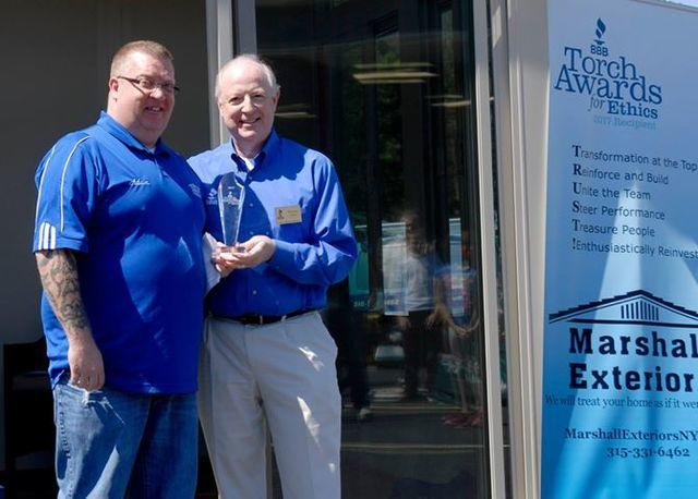 Members of Marshall Exteriors, LLC team with award for ethics