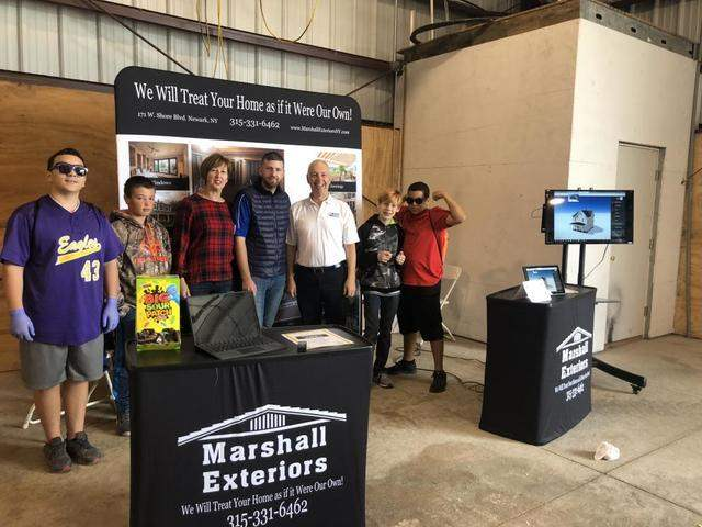 Family at the Marshall Exteriors, LLC booth at the career carnival