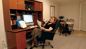 home office with woman at her desk